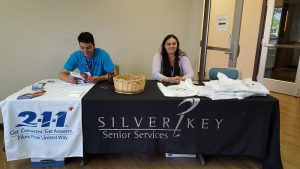 Silver Key Senior Services staff work at a table of resources during a day of workshops for World Elder Abuse Awareness Day on June 15.