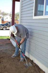 El Paso County Commissioner Stan VanderWerf works at a Pikes Peak Habitat for Humanity home site in Fountain.