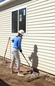 DHS Executive Director Julie Krow works at a Pikes Peak Habitat for Humanity home site in Fountain.