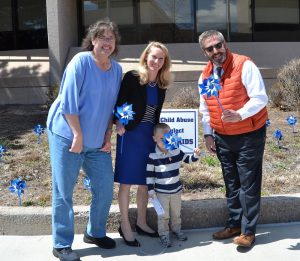 From left, Commissioner Holly Williams, Commissioner Came Bremer, and Commissioner Mark Waller planted pinwheels April 18, 2019, for Child Abuse Prevention Month. The pinwheels serve as symbols of the happy, playful childhoods desired for all children.