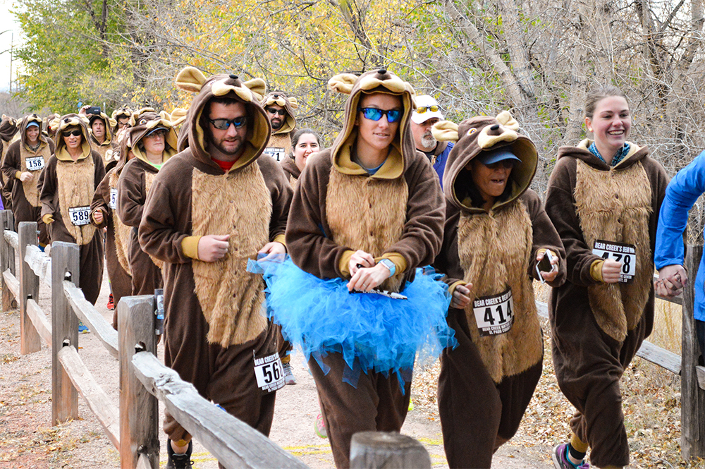 Runners in bear suits at the Bear Creek Nature Center Bear Run