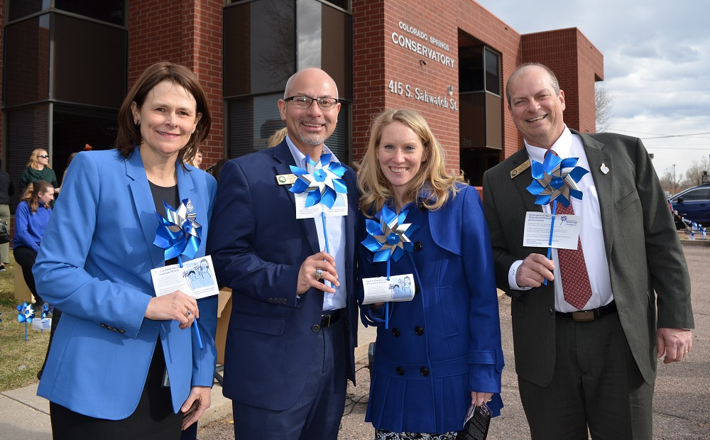 From left, El Paso County Department of Human Services Director Julie Krow, Commissioner Longinos Gonzalez Jr., Commissioner Cami Bremer, and Commissioner Stan VanderWerf at Colorado Springs Conservatory Monday, April 1, 2019, to mark the beginning of national Child Abuse Prevention Month.