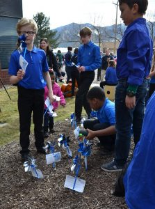 Children plant pinwheels at the Colorado Springs Conservatory on Monday, April 1, 2019. April is national Child Abuse Prevention Month.