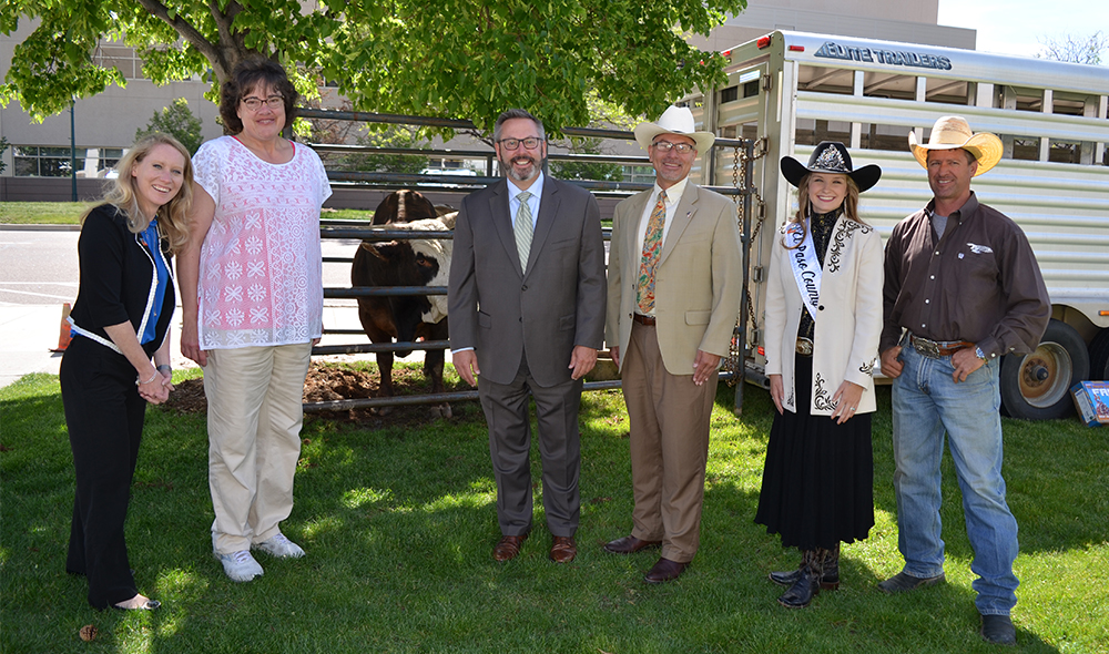 Commissioners with fair queen and bull owner Ty