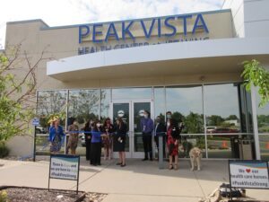 A group including DHS and Peak Vista staff celebrate the opening of a new location on Jetwing Drive
