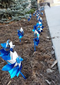 Pinwheels are planted in front of Centennial Hall in downtown Colorado Springs on Monday, April 12, 2021. Blue pinwheels symbolize the happy childhood desired for all children and are the symbols for national Child Abuse Prevention Month in April.