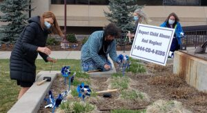 El Paso County Department of Human Services staff plant pinwheels in front of Centennial Hall in downtown Colorado Springs on Tuesday, April 13, 2021, to mark national Child Abuse Prevention Month. Blue pinwheels symbolize the happy childhood desired for all children.