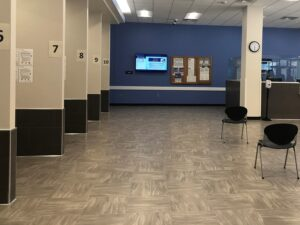 A photo showing chairs and dividers for numbered counters in the new Department of Human Services lobby. The El Paso County Department of Human Services main lobby is on the first floor of the Citizens Service Center building. The new lobby opened at the very end of February 2021.